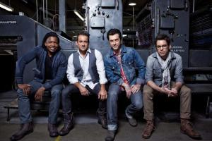 Tait (left) with the Newsboys